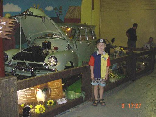 Leo standing in front of early Holden
